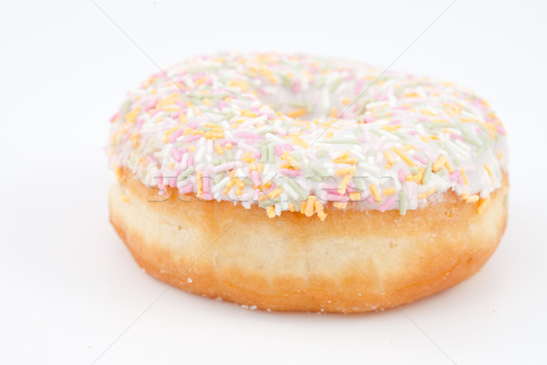 Close up of a doughnut with multi coloured icing sugar against a white background Stock photo © wavebreak_media