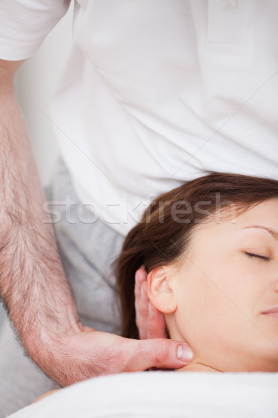 Close-up of woman being manipulating by a therapist in a room Stock photo © wavebreak_media
