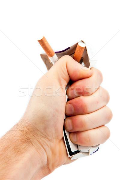Hand crushing a cigarette pack against a white background Stock photo © wavebreak_media