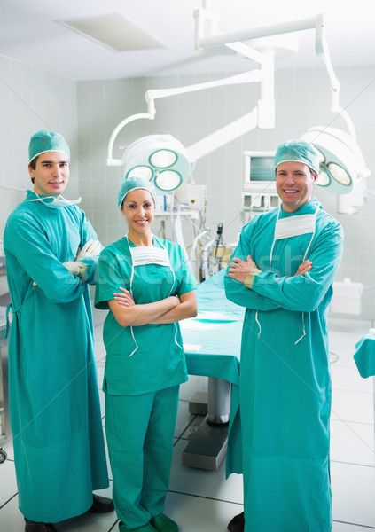 Surgeons smiling with arms crossed in an operating theatre Stock photo © wavebreak_media
