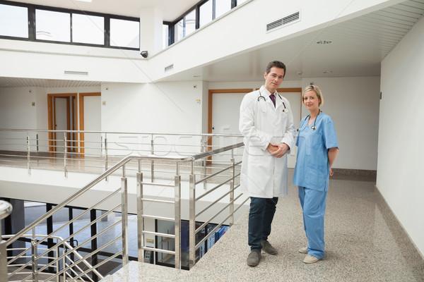 Nővér orvos áll folyosó mosolyog nő Stock fotó © wavebreak_media
