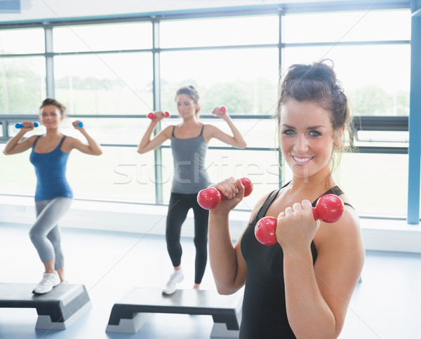Three happy women doing aerobics in gym Stock photo © wavebreak_media