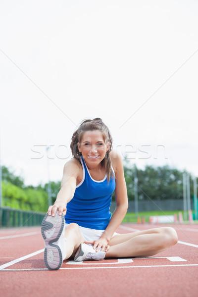 Nő nyújtás lábak fut útvonal sport Stock fotó © wavebreak_media