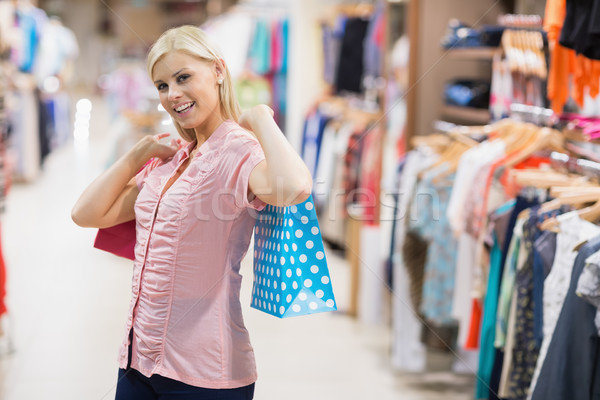 Woman stretching arms with bags Stock photo © wavebreak_media