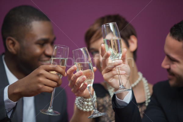 Three people toasting and celebrating in a casino while sitting at table Stock photo © wavebreak_media