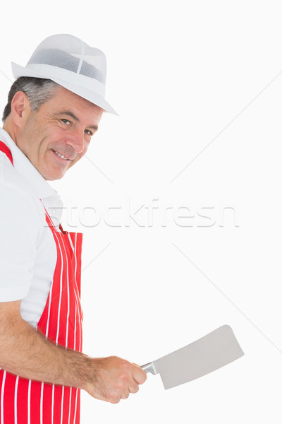 Mature butcher wielding meat cleaver and smiling Stock photo © wavebreak_media