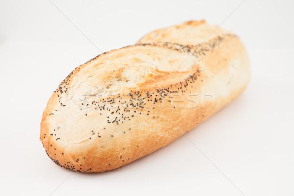Poppy seed baguette lying on white background  Stock photo © wavebreak_media