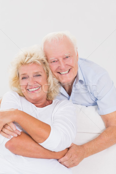 улыбаясь стариков сидят диван женщину Сток-фото © wavebreak_media