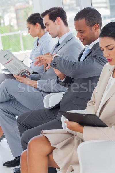 Pessoas de negócios linha sala de espera escritório janela terno Foto stock © wavebreak_media