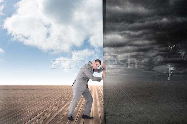 Composite image of businessman pushing away scene Stock photo © wavebreak_media