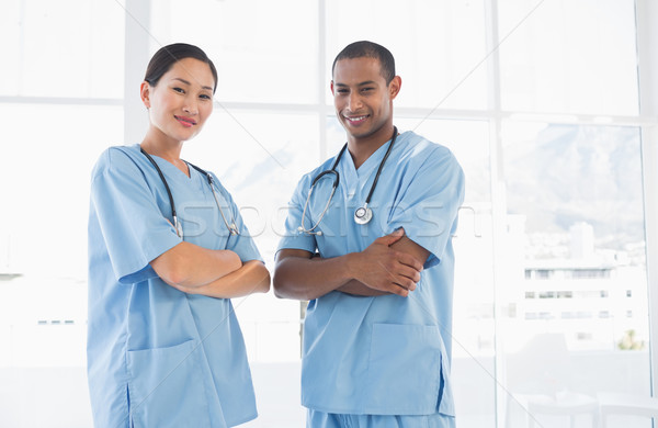 Confident surgeons with arms crossed in hospital Stock photo © wavebreak_media