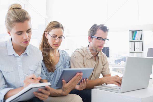 Zagęszczony trzy młodych ludzi biuro pracy jasne Zdjęcia stock © wavebreak_media