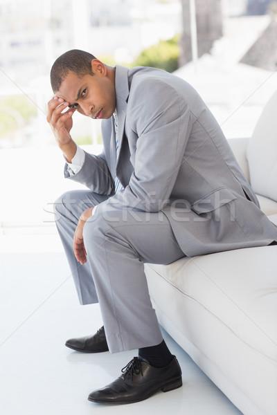 Preocupado empresário sessão sofá cabeça mão Foto stock © wavebreak_media