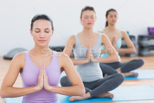 Mulheres namaste posição fitness estúdio Foto stock © wavebreak_media
