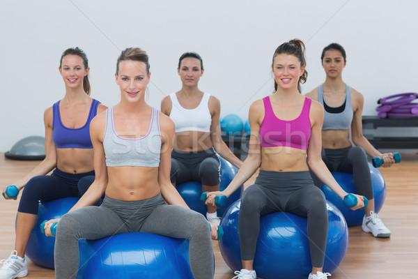 Kadın egzersiz dambıl uygunluk gülen Stok fotoğraf © wavebreak_media