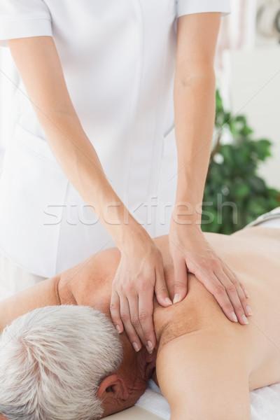 Massagem terapeuta de volta senior homem Foto stock © wavebreak_media