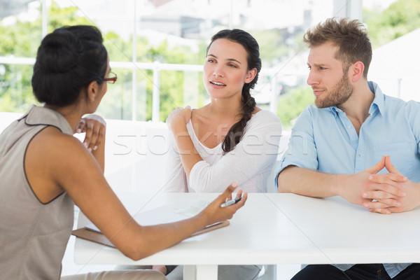 Therapist talking with couple sitting at desk Stock photo © wavebreak_media