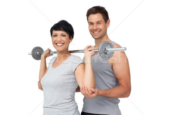 Personal trainer helpen vrouw gewichtheffen bar persoonlijke Stockfoto © wavebreak_media
