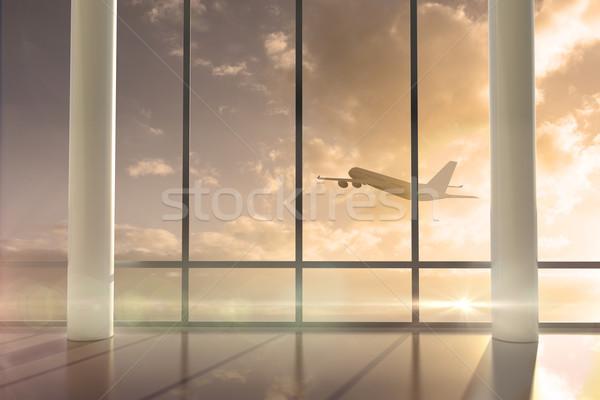 Avión vuelo pasado ventana amanecer digitalmente Foto stock © wavebreak_media