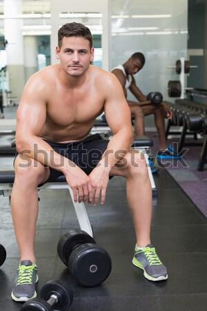Shirtless bodybuilder holding protein drink sitting on bench Stock photo © wavebreak_media