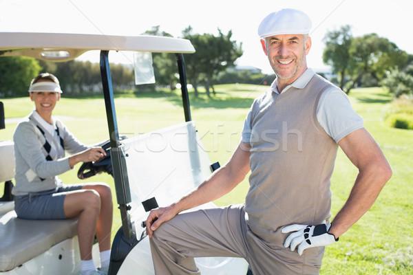Mutlu golf çift gülen kamera Stok fotoğraf © wavebreak_media