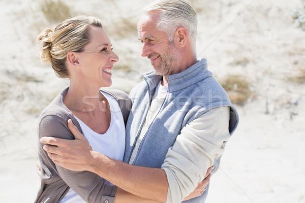 Feliz casal praia olhando outro Foto stock © wavebreak_media