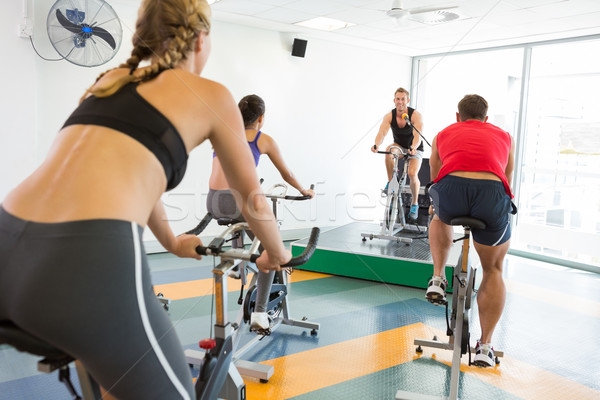 Spin class working out with motivational instructor Stock photo © wavebreak_media