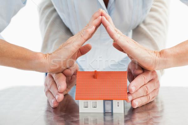 Couples hands with model house Stock photo © wavebreak_media