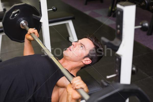 Determinato muscolare uomo bilanciere giovani Foto d'archivio © wavebreak_media