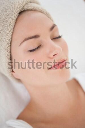 Mooie vrouw ontspannen handdoek tulband spa hotel Stockfoto © wavebreak_media