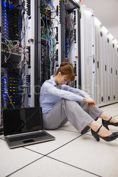 Stressed technician sitting on floor beside open server Stock photo © wavebreak_media