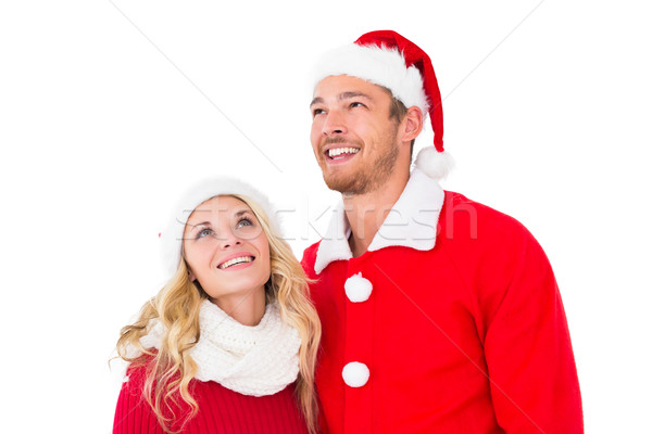 Festive couple smiling and looking up Stock photo © wavebreak_media
