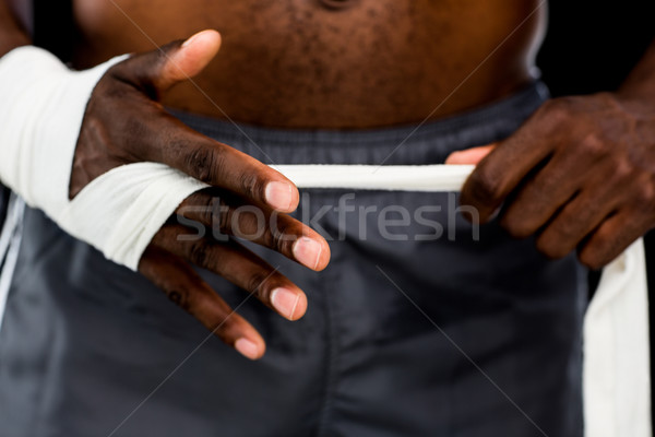Mid section of a man binds bandage on hand Stock photo © wavebreak_media