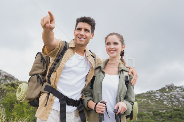 Couple pointing on country terrain Stock photo © wavebreak_media