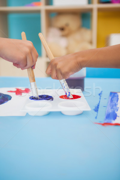 Cute little boys painting at table in classroom Stock photo © wavebreak_media