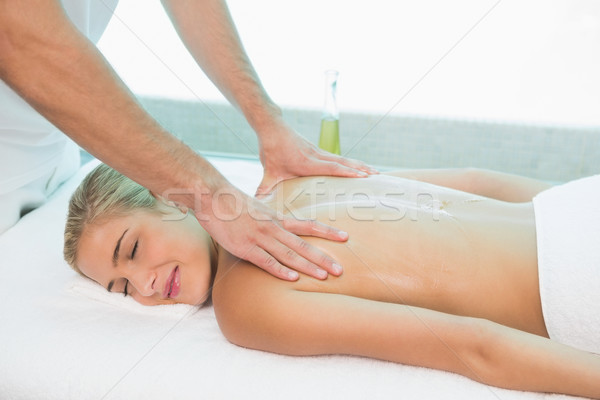 Woman receiving back massage at spa center Stock photo © wavebreak_media