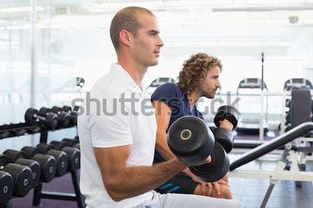 Personal trainer yardım müşteri asansör dambıl spor salonu Stok fotoğraf © wavebreak_media