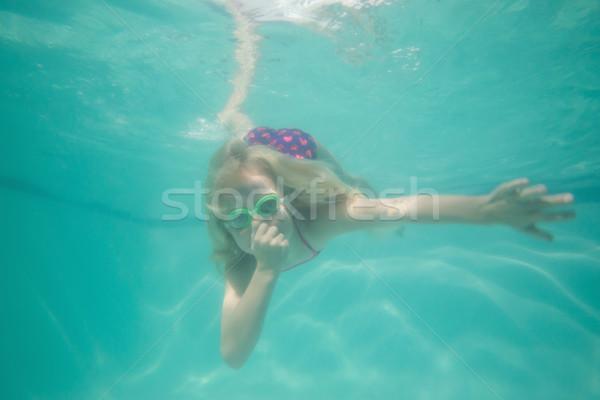 Cute kid posing underwater in pool Stock photo © wavebreak_media