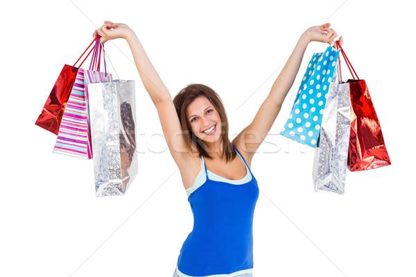 Brunette woman raising shopping bags Stock photo © wavebreak_media