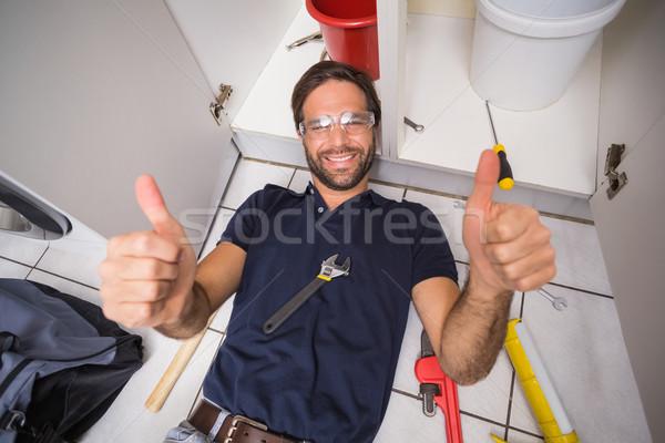 Plumber fixing under the sink Stock photo © wavebreak_media
