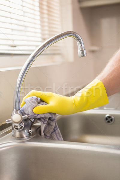 Hand cleaning a sink with cloth Stock photo © wavebreak_media