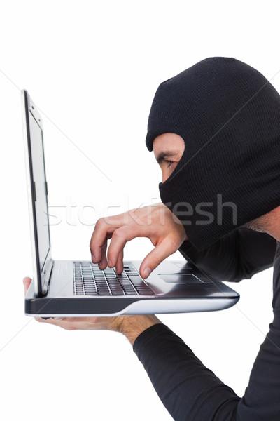 Odaklı hırsız yazarak dizüstü bilgisayar beyaz adam Stok fotoğraf © wavebreak_media