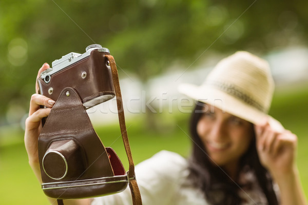 Smiling brunette taking a selfie with retro camera Stock photo © wavebreak_media