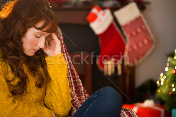 Beauty redhead getting headache at christmas Stock photo © wavebreak_media