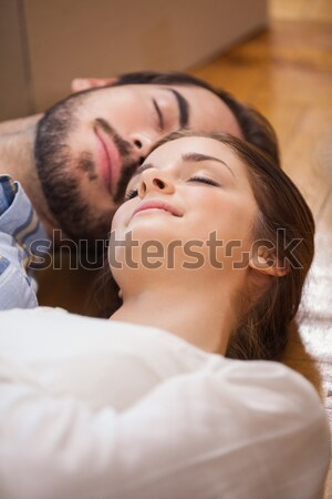 Cute couple sleeping on the floor Stock photo © wavebreak_media