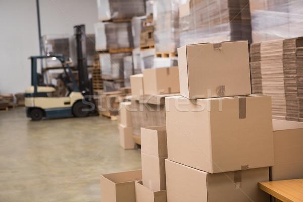 Targonca nagy raktár sorok dobozok üzlet Stock fotó © wavebreak_media