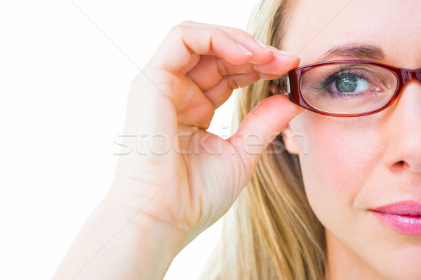 Close up of pretty blonde with red reading glasses Stock photo © wavebreak_media