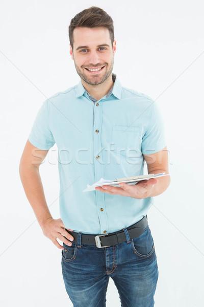 Lächelnd Kurier Mann Zwischenablage Porträt weiß Stock foto © wavebreak_media