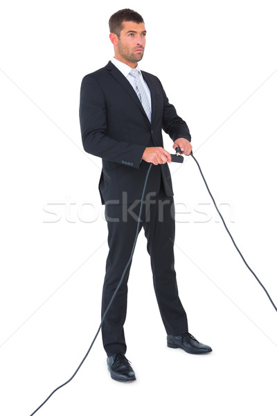 Businessman connecting a plug Stock photo © wavebreak_media