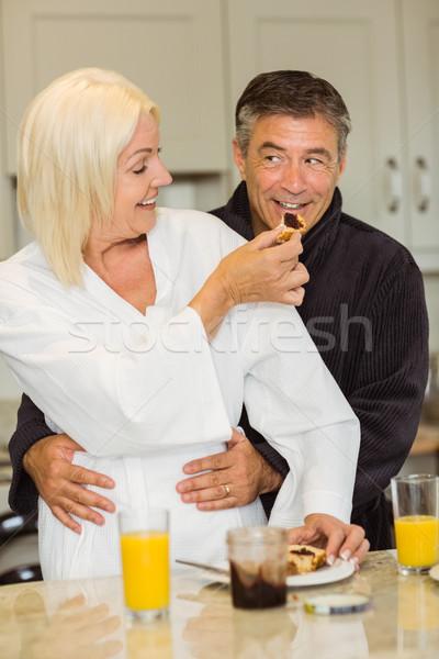 Volwassen paar ontbijt samen home keuken Stockfoto © wavebreak_media